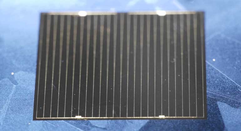 Fraunhofer ISE | The multicrystalline world record solar cell made of n-type HPM silicon with an area of 2 cm x 2 cm. The cell has excellent antireflection properties; therefore the cell appears almost black with almost no detectable grain boundaries.