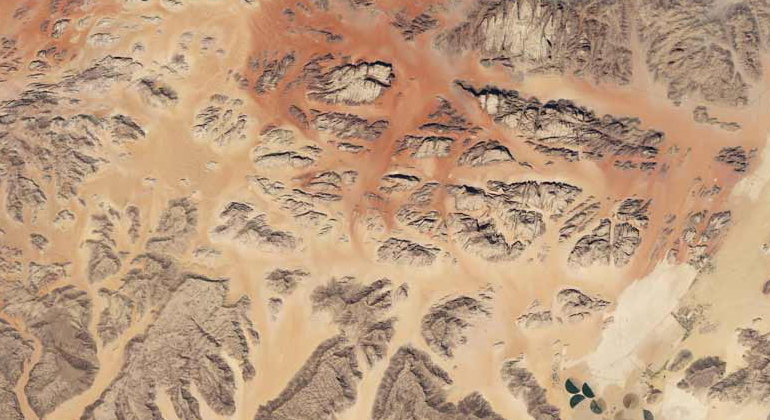 NASA | This satellite image shows the Wadi Rum desert and irrigated farmland in Jordan