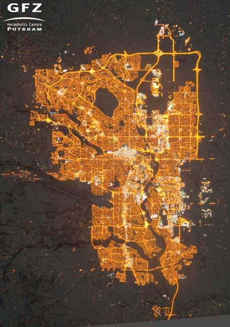 NASA's Earth Observatory/Kyba, GFZ | Photograph of Calgary, Alberta, Canada, taken from the International Space Station on December 23, 2010. Residential areas are mainly lit by orange sodium lamps.