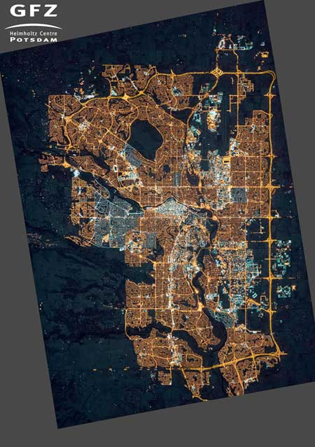 NASA's Earth Observatory/Kyba, GFZ | Photograph of Calgary, Alberta, Canada, taken from the International Space Station on November 27, 2015. Many areas on the outskirts are newly lit compared to 2010, and many neighborhoods have switched from orange sodium lamps to white LED lamps.