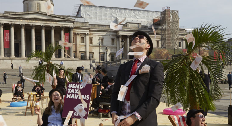 Andy Hall/Oxfam | In the wake of the Panama Papers scandal in 2016, tax campaigners turned London's Trafalgar Square into a tropical tax haven, putting pressure on world leaders to take action on tax dodging at an international Anti-Corruption Summit.