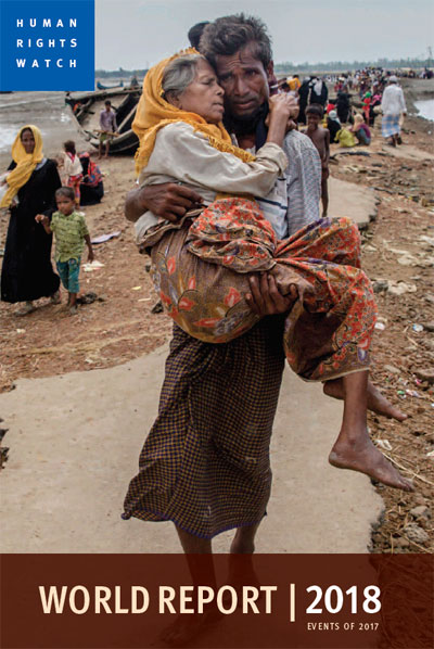 Human Rights Watch | 2017 Dar Yasin/AP | World Report 2018 | Abdul Kareem, a Rohingya Muslim, carries his mother, Alima Khatoon, to a refugee camp after crossing from Burma into Bangladesh on Sept. 16, 2017.