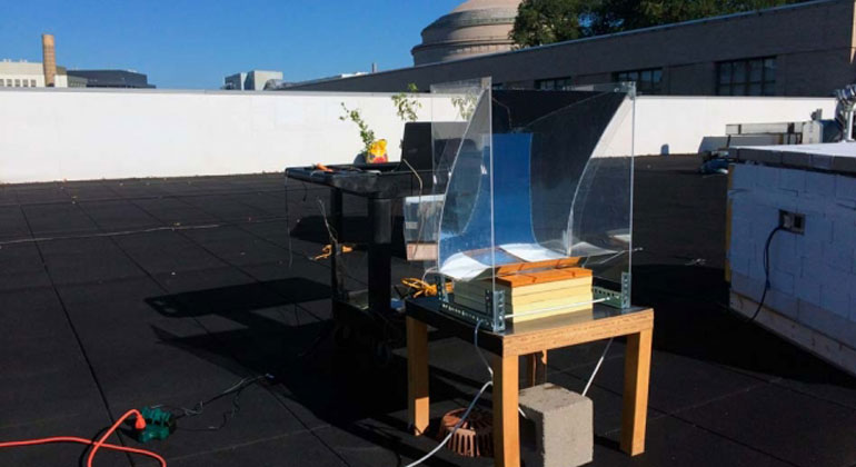 mit.edu | Courtesy of the researchers | In this experiment, the new steam-generating device was mounted over a basin of water, placed on a small table, and partially surrounded by a simple, transparent solar concentrator. The researchers measured the temperature of the steam produced over the course of the test day, Oct. 21, 2017.
