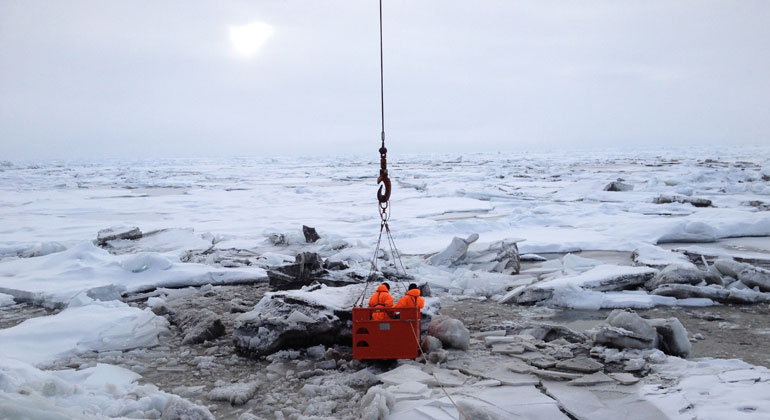 Alfred-Wegener-Institut / Rüdiger Stein   The transport of sediments and nutrients trapped in the ice in the shallow zones of the Arctic marginal seas is also interrupted. The image shows sediment-rich sea ice in the Transpolar Drift. Two researchers were lowered by crane from the decks of the icebreaker Polarstern to the surface of the ice, so as to collect samples.