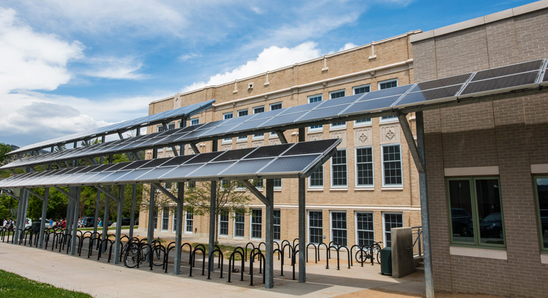 Dennis Schroeder | NREL | Solar panels provide shade and energy at Casey Middle School in Boulder, Colorado