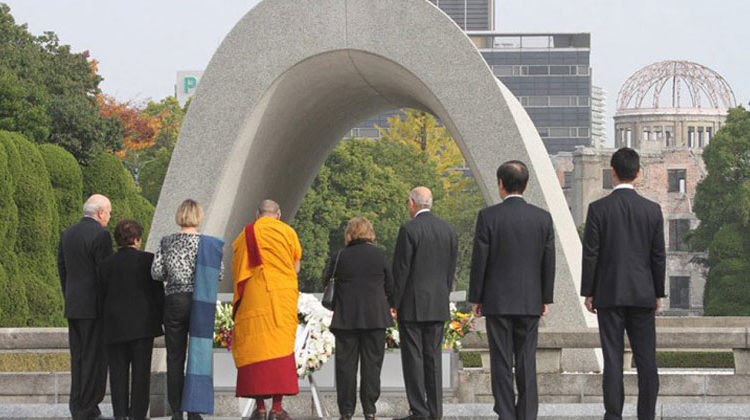 Taikan Usui_His Holiness the Dalai Lama and fellow Nobel Laureates paying their respects at Hiroshima Memorial Park in Hiroshima, Japan on November 14, 2010.